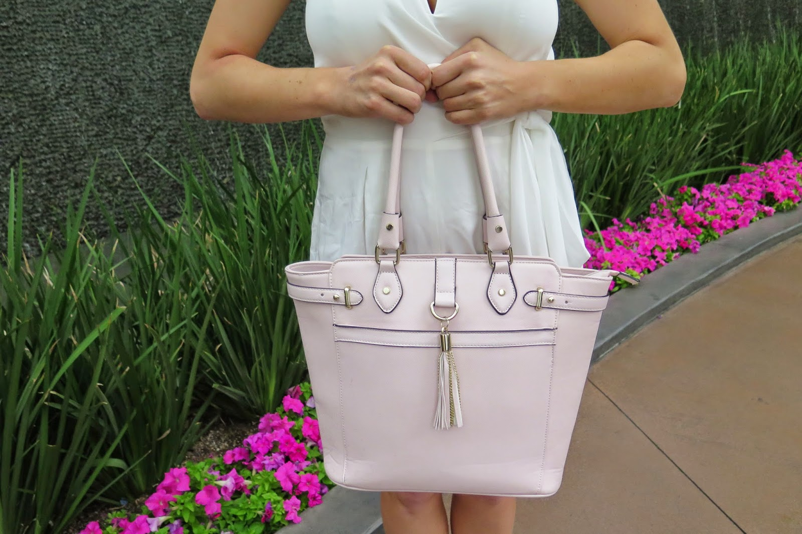 pastel pink handbag with tassel