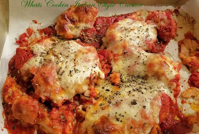 this is chicken baked with mozzarella cheese and tomato sauce.