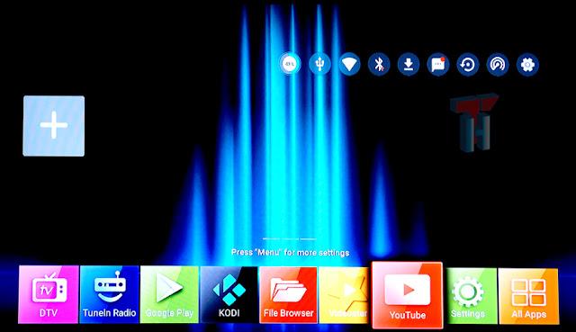 Se muestra la pantalla principal con las opciones de configuración y los iconos de selección de DTV, TuneIn Radio,Google Play,KODI, File Browser, YouTube, Settings y All Apps.