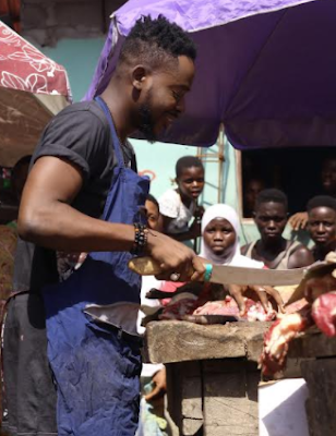 Photos: Adekunle Gold turns to meat seller