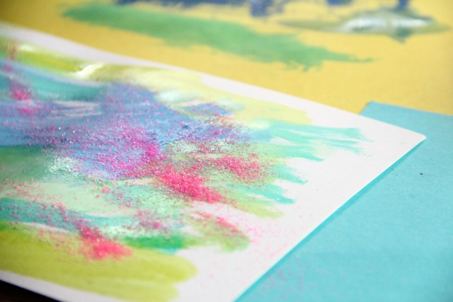 Glitter and watercolors are all you need for creative lacing cards and fine motor skills development in kids.