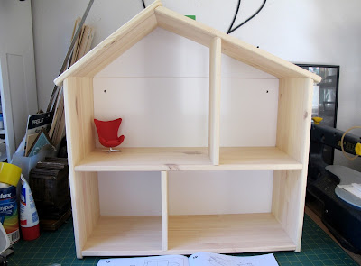 Completed IKEA FLISAT dolls' house with a 1/12 scale egg chair in one room for scale.