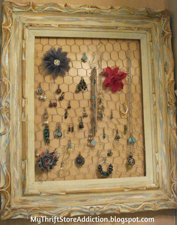 Vintage frame and chicken wire jewelry display