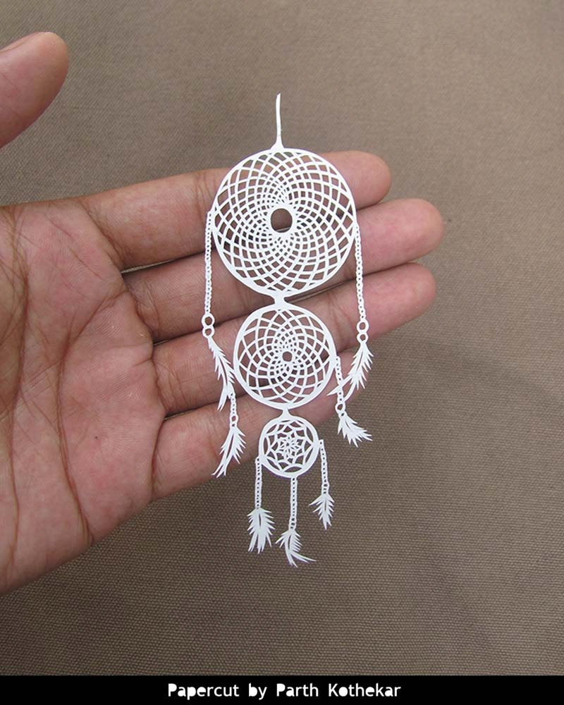 16-Crochet-Dreamcatcher-Parth-Kothekar-Beauty-and-Precision-in-Paper-Cut-Silhouettes-www-designstack-co