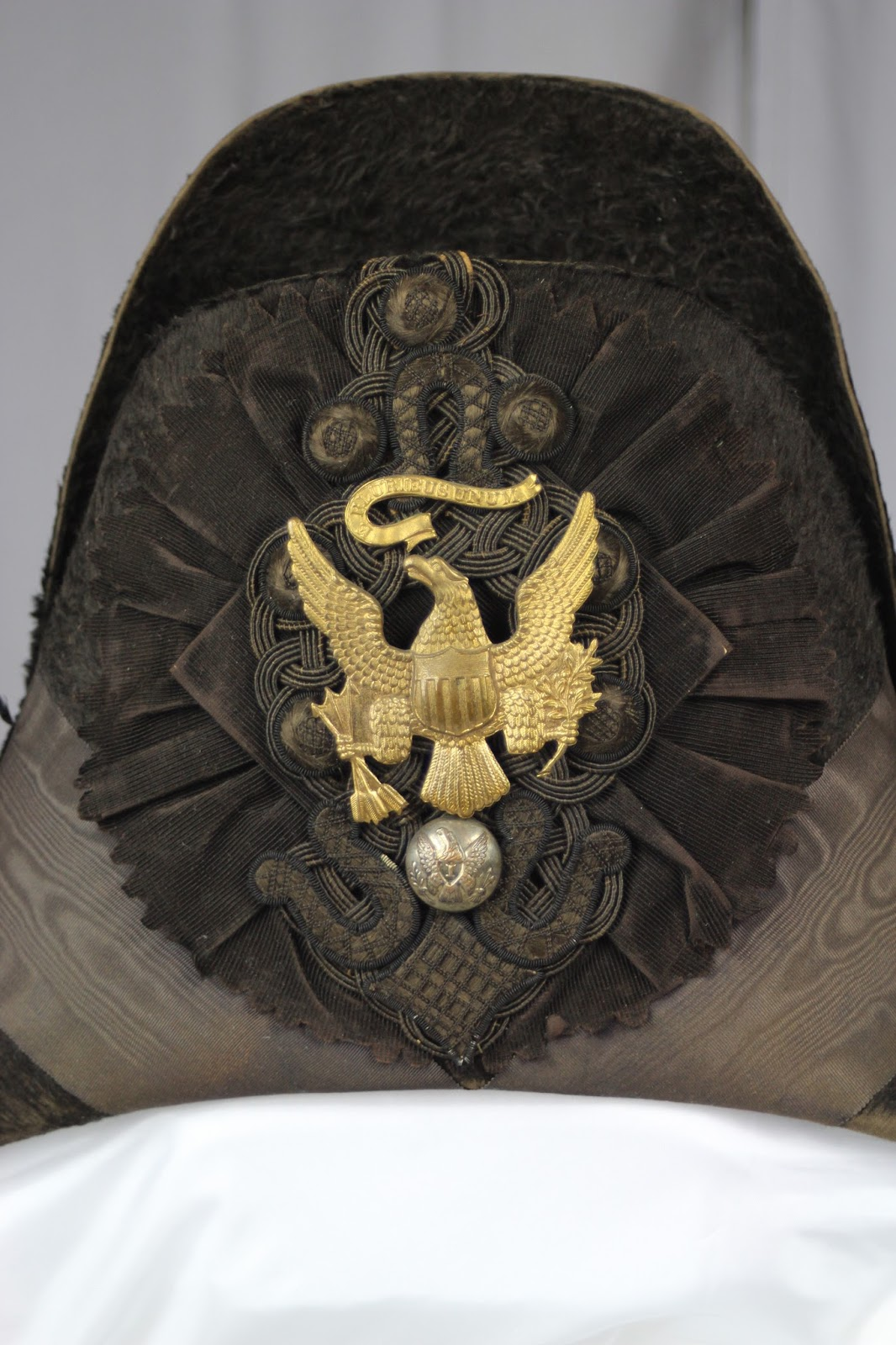 Before treatment photo of military chapeau c. 1832. The hat would be  conserved by
