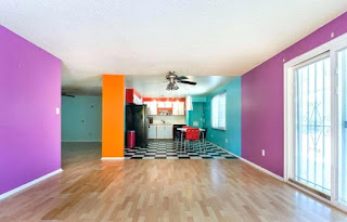 An inside image of house with wall painted orange and purple