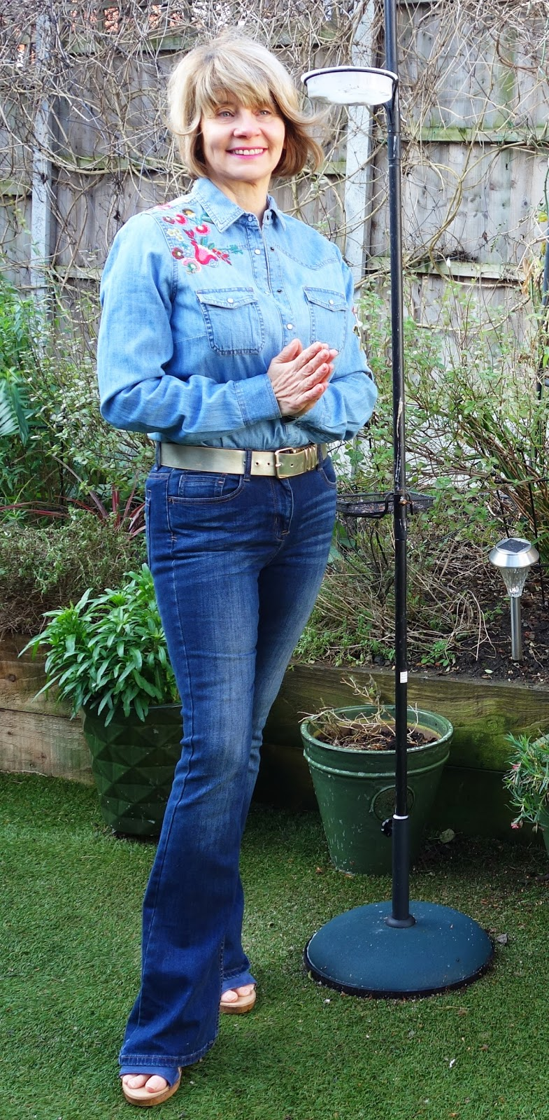 Embroidered denim shirt and flared jeans