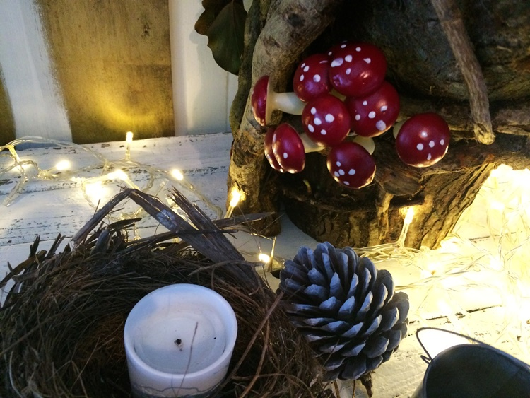 Woodland Campfire party table decor - birds nest, toadstools and pinecones