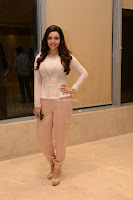 Kyra Dutt in Tight White Top Trousers at Paisa Vasool audio success meet ~  Exclusive Celebrities Galleries 042.JPG