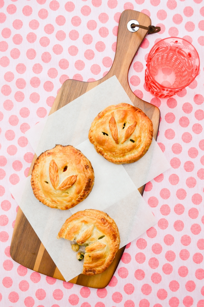 Flaky chickpea and vegetable hand pies on a picnic rug