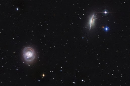 Image of the spiral galaxy NGC 1055 and M77 in the Cetus constellation