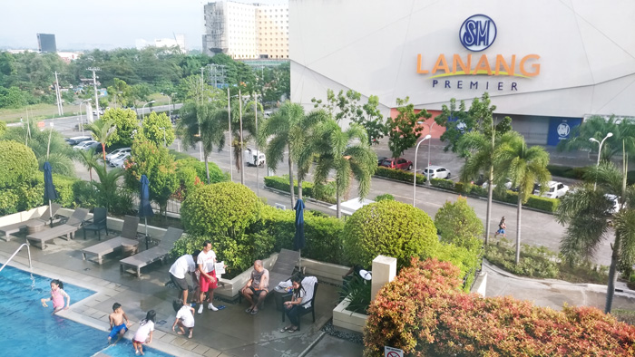 Outdoor pool of Park Inn by Radisson Davao   with a good view of SM Lanang Premier