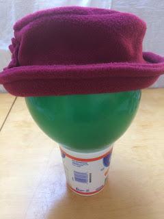 Maroon fleece hat with upturned brim.