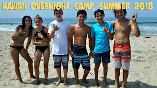Six Aloha Beach Camp kids standing on the beach together with the ocean in the background at Aloha Beach Camp's Hawaii Overnight Summer Camp program.
