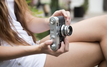 Wallpaper: Miss with a retro photo camera