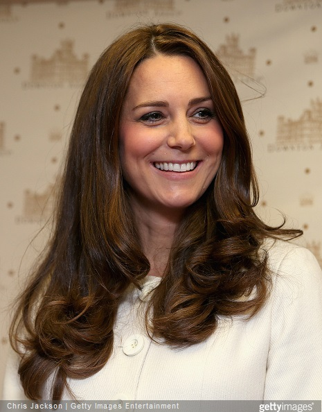 Catherine, Duchess of Cambridge smiles during an official visit to the set of Downton Abbey at Ealing Studios