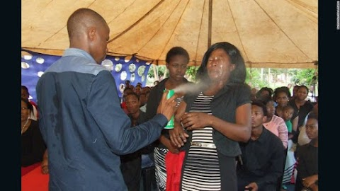 Pastor sprays insecticide into the faces of  his congregants