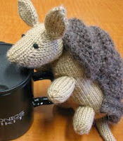 http://www.ravelry.com/patterns/library/don-the-dillo-knit-armadillo