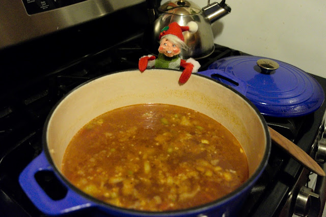 The lentil soup simmering on the stove.