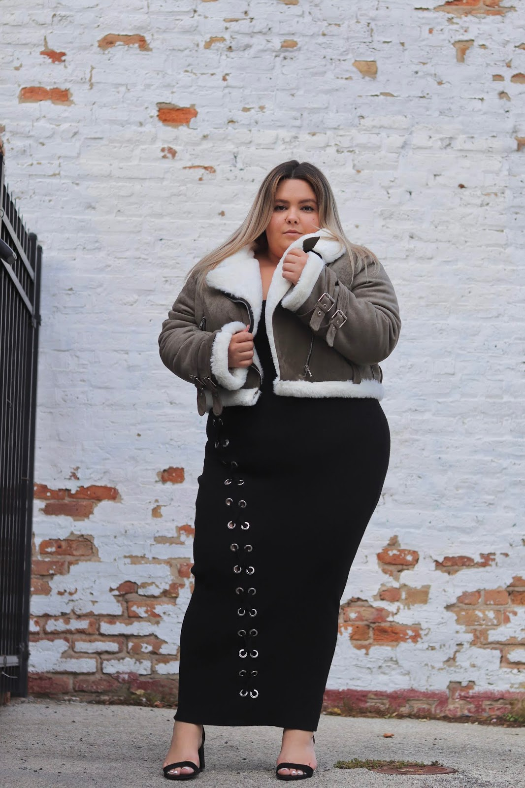 Chicago Plus Size Petite Fashion Blogger, influencer, YouTuber, and model Natalie Craig, of Natalie in the City, reviews Fashion Nova Curve's Faux Shearling Cropped Moto Jacket and sweater maxi dresses.
