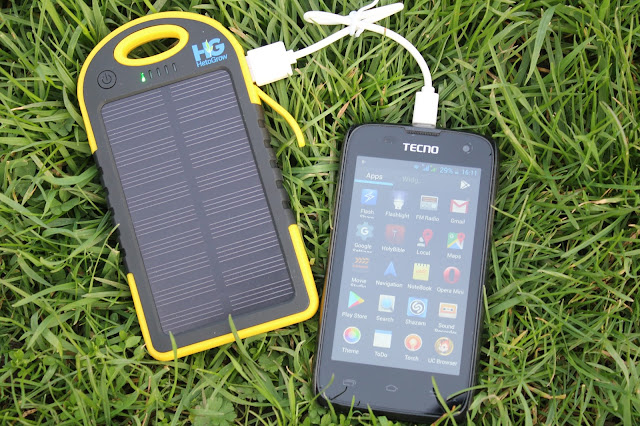 HG solar power bank charging in the park