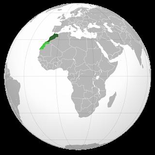 Изображение контуров Марокко на глобусе Мира