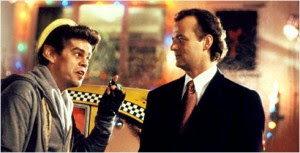 Bill Murray talking to a taxi driver in Scrooged 1988 movieloversreviews.filminspector.com