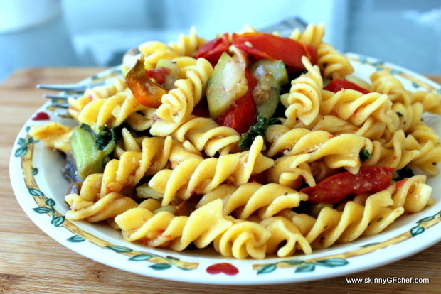 Gluten-Free Warm or Cold Pasta Salad amps up the flavor with sauteed zucchini, kale, tomatoes and mushroomsor Cold this Pasta Salad with sauteed zucchini, kale, tomatoes and mushrooms