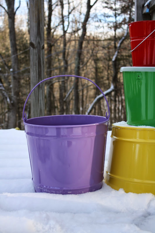 A Metal and Solid Color Bucket photoshoot in the snow.