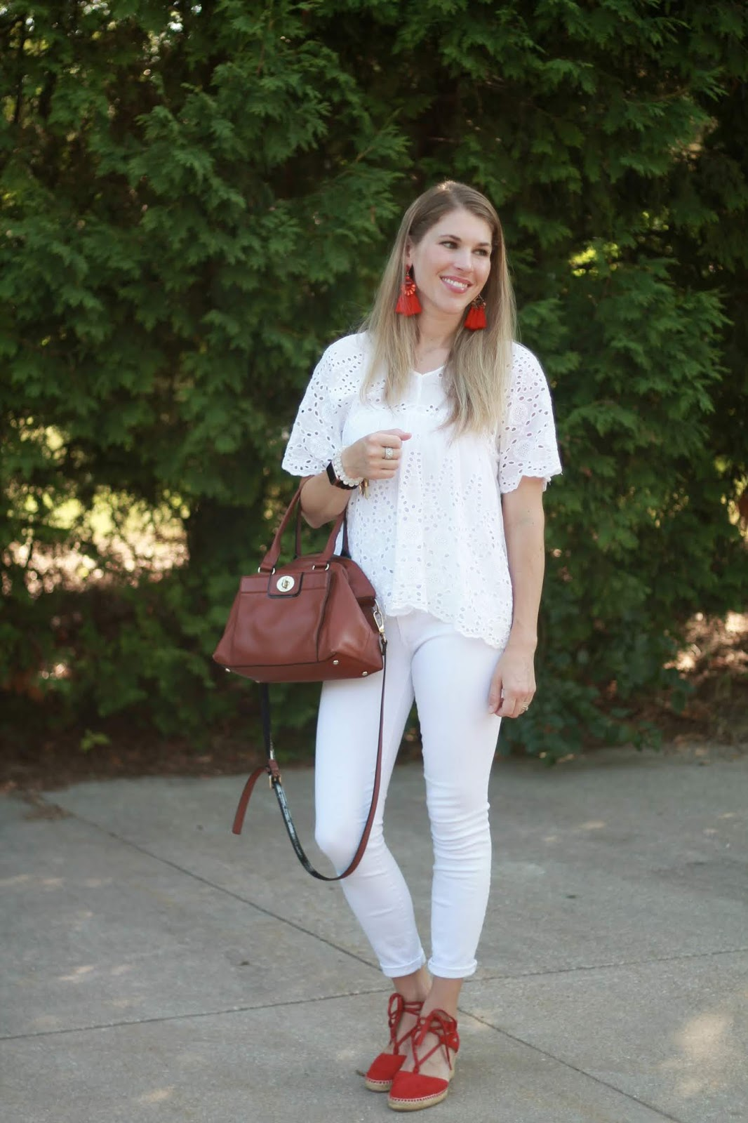 white eyelet top, white jeans, red lace up espadrilles, Kate Spade cognac satchel,