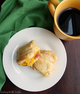 sliders with scrambled eggs, ham and cheese with cup of coffee