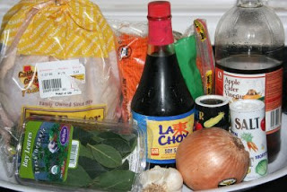 the ingredients for making chicken adobo in the crockpot slow cooker