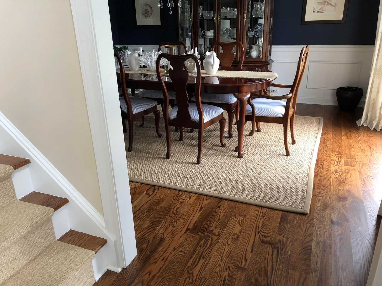 Seagrass rug in navy dining room