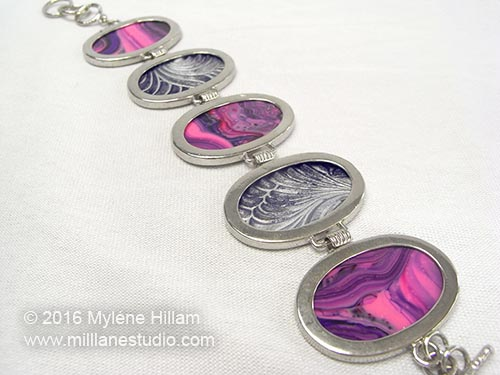 Marbled and Textured oval resin bracelet by Myléne Hillam - Mill Lane Studio. Once the resin has cured, cut out the ovals and adhere one in each of the bezel blanks using either 5-minute Araldite or E6000.