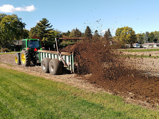 tractor spreading manure.