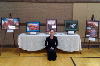 "Audrey with Cramer Imaging's framed and matted fine art photographs at the ""Expressions of Light"" art exhibition in Pocatello, Idaho"