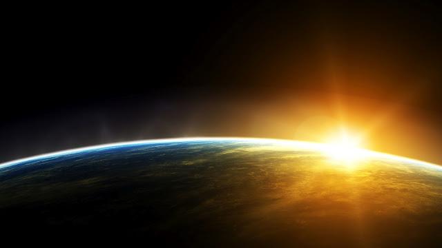 De Aarde en een opkomende zon