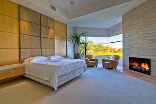 Dormitorio moderno con chimenea