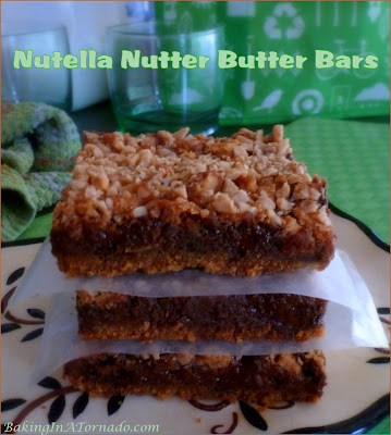 Nutella Nutter Butter Bars are for all of the chocolate and peanut butter lovers in our lives. | Recipe developed by www.BakingInATornado.com | #recipe #dessert