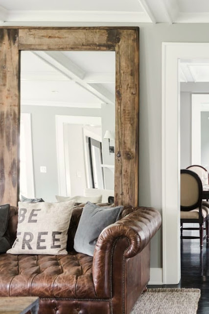 Be free pillow on leather sofa in modern farmhouse living room on Hello Lovely Studio
