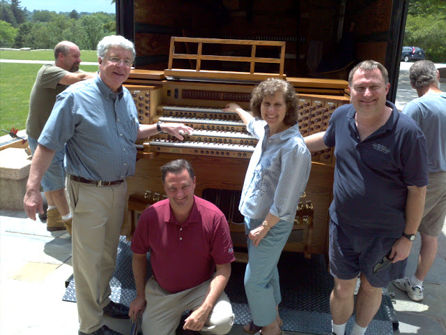 New Allen Organ console being unloaded with Terry Schnarr, Ken Coye organsits and Jim Adams Bryn Athyn Cathedral administrtor