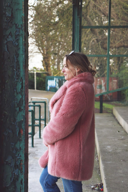 Pink faux fur coat by Carrie Fry