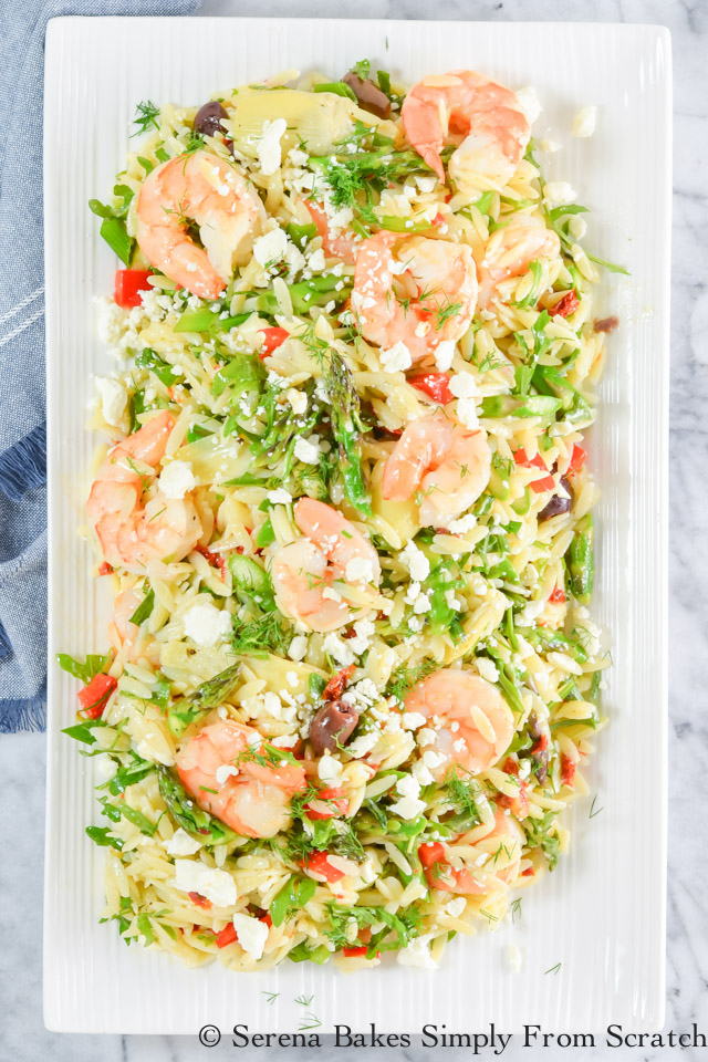 Roasted Shrimp Asparagus Orzo Pasta Salad with artichokes, sun-dried tomatoes, olives, feta, and arugula with a lemon dill basil vinaigrette from Serena Bakes Simply From Scratch.