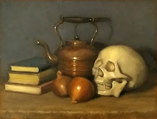 Still life oil painting of a plastic skull beside onions, a copper teapot and some books.