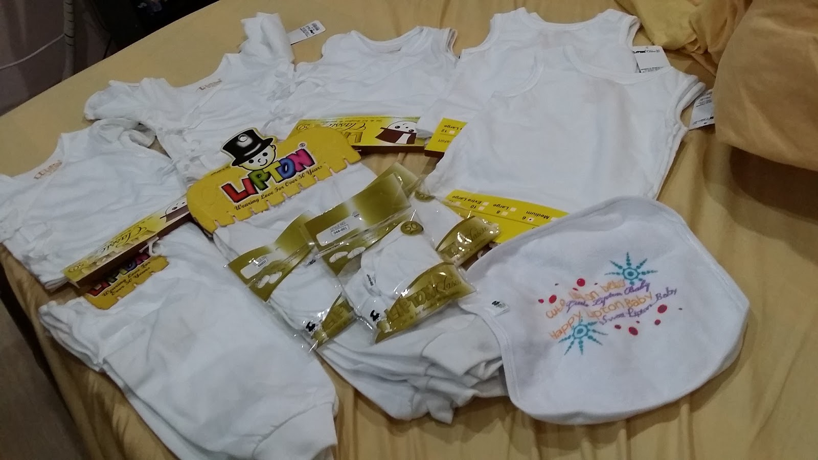 730fddc9b5f6 ... that sells Lipton baby clothes and I was not disappointed because I  found this shop called Lipton Baby Garments and Accessories. I bought the  following