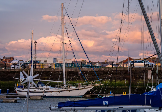 Photo of sunset over Maryport Marina and caravan site