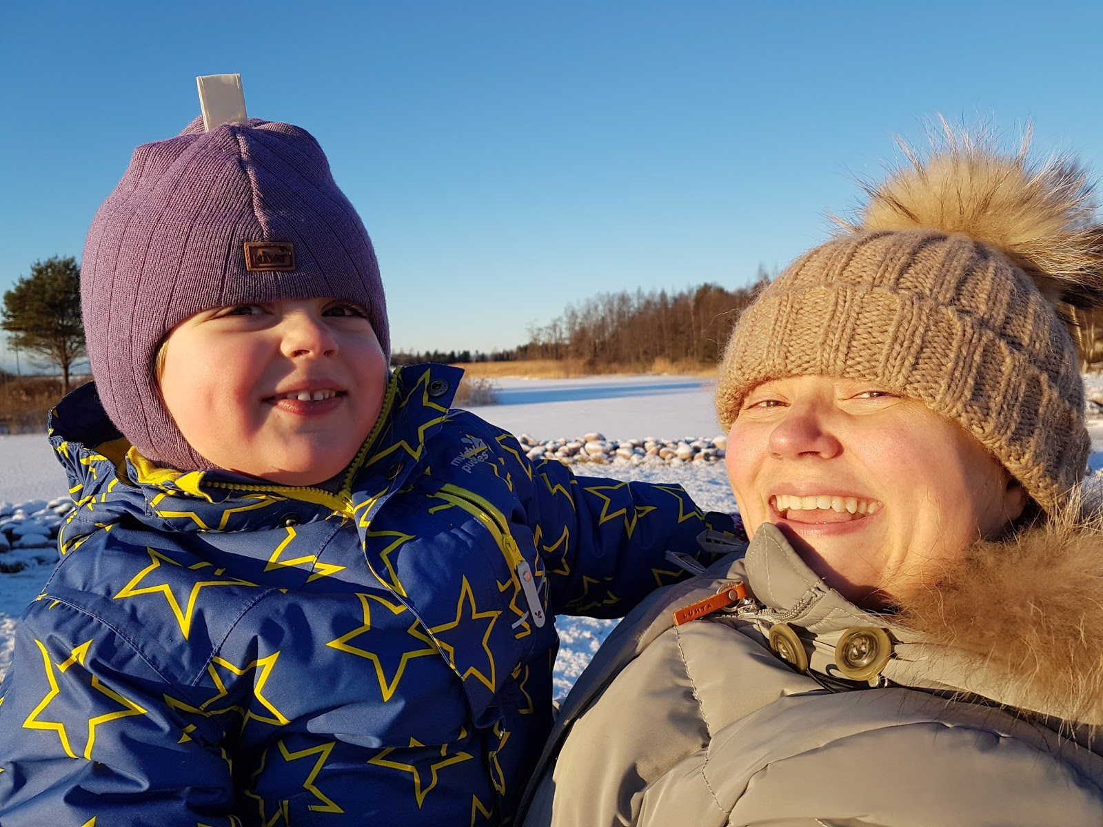 mum and daughter in freezing Finland and smiling