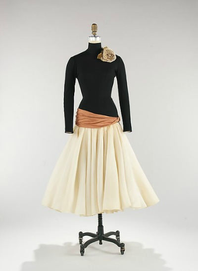 Black and beige Norman Norell dinner dress on dress form