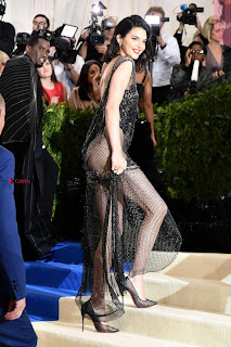 Kendall Jenner in a gorgeous Transparent Nude Skin tight fishnet at 2017 MET Costume Institute Gala at The Metropolitan Museum of Art in NYC