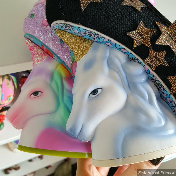 new and old unicorn heels being held in hand